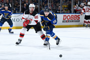 Marcus Johansson #90 of the New Jersey Devils and Brayden Schenn #10 of the St. Louis Blues battle at Scottrade Center on January 2, 2018 in St. Louis, Missouri.