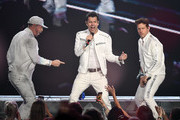 (L-R) Singers Donnie Wahlberg, Jordan Knight and Joey McIntyre of New Kids on the Block perform during a stop of the Mixtape Tour at the Mandalay Bay Events Center on May 25, 2019 in Las Vegas, Nevada.