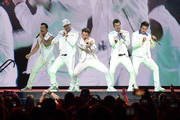 Danny Wood, Donnie Wahlberg, Joey McIntyre, Jordan Knight and Jonathan Knight of the musical group New Kids On The Block perform at Bridgestone Arena on May 09, 2019 in Nashville, Tennessee.