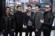 """Danny Wood, Joey McIntyre, Jordan Knight, Jonathan Knight and Donnie Wahlberg of New Kids On The Block visit """"Extra"""" at The Levi's Store Times Square on March 08, 2019 in New York City."""