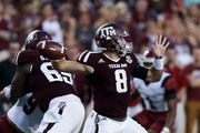 Trevor Knight #8 of the Texas A&M Aggies looks for a receiver against the New Mexico State Aggies at Kyle Field on October 29, 2016 in College Station, Texas.