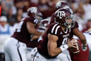 Trevor Knight #8 of the Texas A&M Aggies rolls out as he looks for a receiver against the New Mexico State Aggies at Kyle Field on October 29, 2016 in College Station, Texas.