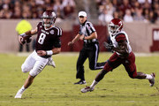 Trevor Knight #8 of the Texas A&M Aggies runs with the ball as Terrill Hanks #2 of the New Mexico State Aggies pursues at Kyle Field on October 29, 2016 in College Station, Texas.