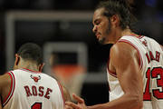 Joakim Noah #13 of the Chicago Bulls congratulates Derrick Rose #1 after Rose hit a late shot against the New Orleans Hornets at the United Center on February 28, 2012 in Chicago, Illinois. The Bulls defeated the Hornets 99-95. NOTE TO USER: User expressly acknowledges and agrees that, by downloading and or using this photograph, User is consenting to the terms and conditions of the Getty Images License Agreement.