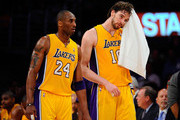 Kobe Bryant #24 and Pau Gasol #16 of the Los Angeles Lakers walk from the sideline while taking on the New Orleans Hornets in Game Two of the Western Conference Quarterfinals in the 2011 NBA Playoffs on April 20, 2011 at Staples Center in Los Angeles, California. NOTE TO USER: User expressly acknowledges and agrees that, by downloading and or using this photograph, User is consenting to the terms and conditions of the Getty Images License Agreement.