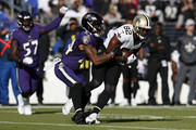 Tight end Benjamin Watson #82 of the New Orleans Saints is tackled by cornerback Brandon Carr #24 of the Baltimore Ravens in the first quarter at M&T Bank Stadium on October 21, 2018 in Baltimore, Maryland.