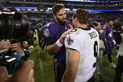 Quarterback Joe Flacco #5 of the Baltimore Ravens and quarterback Drew Brees #9 of the New Orleans Saints talk after the New Orleans Saints beat the Baltimore Ravens 24-23 at M&T Bank Stadium on October 21, 2018 in Baltimore, Maryland.