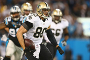 Jimmy Graham #80 of the New Orleans Saints runs from the Carolina Panthers defense in the 1st half during their game at Bank of America Stadium on October 30, 2014 in Charlotte, North Carolina.