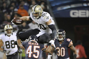 Jimmy Graham #80 of the New Orleans Saints jumps over Kyle Fuller #23 of the Chicago Bears and Brock Vereen #45 of the Chicago Bears during the fourth quarter at Soldier Field on December 15, 2014 in Chicago, Illinois.