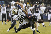 Kyle Fuller #23 of the Chicago Bears is called for pass interference on Jimmy Graham #80 of the New Orleans Saints during the first quarter at Soldier Field on December 15, 2014 in Chicago, Illinois. The Saints defeated the Bears 31-15.