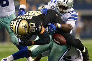 Jimmy Graham #80 of the New Orleans Saints fumbles as he is hit by Justin Durant #52 of the Dallas Cowboys in the second half at AT&T Stadium on September 28, 2014 in Arlington, Texas.