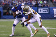 Odell Beckham #13 of the New York Giants runs against Marshon Lattimore #23 of the New Orleans Saints during their game at MetLife Stadium on September 30, 2018 in East Rutherford, New Jersey.