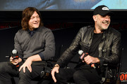 Norman Reedus and Jeffrey Dean Morgan speak onstage during The Walking Dead Universe, Including AMC's Flagship Series and the Untitled New Third Series Within The Walking Dead Franchise at New York Comic Con 2019 Day 3 at Hulu Theater at Madison Square Garden October 05, 2019 in New York City.