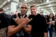 (L-R) Darryl McDaniels and Rob Liefeld pose in artist alley during 2019 New York Comic Con at Jacob Javits Convention Center on October 05, 2019 in New York City.