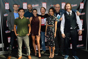 (L-R) Director Chris Williams, actors Ryan Potter, Scott Adsit, and Genesis Rodriguez, director Don Hall, actress Jamie Chung, producer Roy Conli, and actor T.J. Miller attend Walt Disney Studios' 2014 New York Comic Con presentations of 'Big Hero 6' and 'Tomorrowland' at the Javits Convention Center on Thursday October 9, 2014 in New York City.