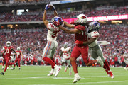 Defensive back Ross Cockrell #37 of the New York Giants intercepts a pass intended for wide receiver Larry Fitzgerald #11 of the Arizona Cardinals in the second half at University of Phoenix Stadium on December 24, 2017 in Glendale, Arizona.