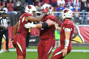 Wide receiver Larry Fitzgerald #11 of the Arizona Cardinals celebrates a thirteen yard touchdown with offensive guard Evan Boehm #70 and quarterback Drew Stanton #5 in the first half of the NFL game against the New York Giants at University of Phoenix Stadium on December 24, 2017 in Glendale, Arizona.