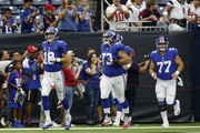 Eli Manning #10 of the New York Giants leads the team onto the field before the game against the Houston Texans at NRG Stadium on September 23, 2018 in Houston, Texas.
