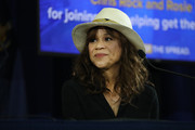 Actor Rosie Perez joins New York Governor Andrew Cuomo and Chris Rock at a press conference where the two performers helped to promote coronavirus testing, social distancing and the use of a face mask on May 28, 2020 in New York City.  The news conference was held at the Madison Square Boys and Girls Club in the Flatbush, Brooklyn neighborhood, one of the hardest hit by Covid-19 in New York City.