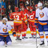 Joe Colborne T.J. Brodie Photos - (L to R) Mike Cammalleri #13, T.J. Brodie #7, Mark Giordano #5, and Joe Colborne #8 of the Calgary Flames celebrate Colborne's goal in front of Kyle Okposo #21 and Matt Donovan #46 of the New York Islanders during an NHL game at Scotiabank Saddledome on March 7, 2014 in Calgary, Alberta, Canada. The Flames defeated the Islanders 4-3. - New York Islanders v Calgary Flames