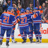 David Perron Ryan Smyth Photos - (L to R) Andrew Ference #21, Ryan Smyth #94, Boyd Gordon #27, Philip Larsen #36, and David Perron #57 of the Edmonton Oilers celebrate after Larsen scored the team's second goal against the New York Islanders during an NHL game at Rexall Place on March 06, 2014 in Edmonton, Alberta, Canada. The Oilers defeated the Islanders 3-2 in overtime. - New York Islanders v Edmonton Oilers