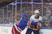 Anders Lee #27 of the New York Islanders is checked by Marc Staal #18 of the New York Rangers during the first period at Madison Square Garden on September 26, 2018 in New York City.