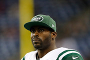 Michael Vick #1 of the New York Jets watches the clock run down from the sidelines during the fourth quarter of the game against the Buffalo Bills at Ford Field on November 24 , 2014 in Detroit, Michigan. The Bills defeated the Jets 38-3.