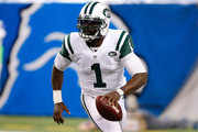 Michael Vick #1 of the New York Jets scrambles to throw a third quarter first down pass against the Buffalo Bills at Ford Field on November 24 , 2014 in Detroit, Michigan.