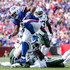 Mike Tolbert Photos - Mike Tolbert #35 of the Buffalo Bills breaks a tackle during the first half against the New York Jets on September 10, 2017 at New Era Field in Orchard Park, New York. - New York Jets vBuffalo Bills