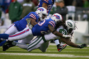 Chris Ivory #33 of the New York Jets is tackled by  Jairus Byrd #31 and  Aaron Williams #23 of the Buffalo Bills  at Ralph Wilson Stadium on November 17, 2013 in Orchard Park, New York. Buffalo won 37-14.
