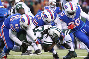 Chris Ivory #33 of the New York Jets is tackled by Mario Butler #39 of the Buffalo Bills, Preston Brown #52 of the Buffalo Bills and Bacarri Rambo #30 of the Buffalo Bills during the second half at Ralph Wilson Stadium on January 3, 2016 in Orchard Park, New York.