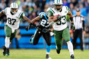 Chris Ivory #33 of the New York Jets turns upfield against the Carolina Panthers during play at Bank of America Stadium on December 15, 2013 in Charlotte, North Carolina.