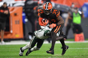 Carlos Hyde #34 of the Cleveland Browns gets wrapped up by Morris Claiborne #21 of the New York Jets during the fourth quarter at FirstEnergy Stadium on September 20, 2018 in Cleveland, Ohio.