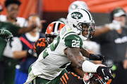 Tyrod Taylor #5 of the Cleveland Browns gets hit while sliding by Trumaine Johnson #22 of the New York Jets during the second quarterat FirstEnergy Stadium on September 20, 2018 in Cleveland, Ohio.