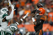 Tyrod Taylor #5 of the Cleveland Browns throws a pass in front of the defense of Brandon Copeland #51 and Jamal Adams #33 of the New York Jets during the first quarter at FirstEnergy Stadium on September 20, 2018 in Cleveland, Ohio.