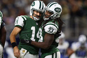 Ryan Fitzpatrick #14 and Chris Ivory #33 of the New York Jets celebrates a touchdown against the Dallas Cowboys in the fourth quarter at AT&T Stadium on December 19, 2015 in Arlington, Texas.