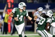 Ryan Fitzpatrick #14 of the New York Jets hands off to Chris Ivory #33 against the Dallas Cowboys during the first quarter at AT&T Stadium on December 19, 2015 in Arlington, Texas.