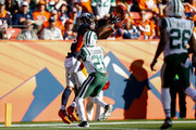 Wide receiver Demaryius Thomas #88 of the Denver Broncos catches a touchdown in front of cornerback Morris Claiborne #21 of the New York Jets during the first quarter at Sports Authority Field at Mile High on December 10, 2017 in Denver, Colorado.