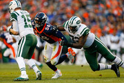 Qutside linebacker Von Miller #58 of the Denver Broncos sacks quarterback Josh McCown #15 of the New York Jets after beating Brandon Shell #72 on a spin move during the third quarter at Sports Authority Field at Mile High on December 10, 2017 in Denver, Colorado.