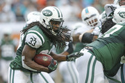 Chris Ivory #33 of the New York Jets runs with the ball against the Miami Dolphins during first quarter action on December 29, 2013 at Sun Life Stadium in Miami Gardens, Florida.