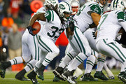 Chris Ivory #33 of the New York Jets carries the ball during the third quarter against the New England Patriots at Gillette Stadium on October 16, 2014 in Foxboro, Massachusetts.