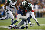 Chris Ivory #33 of the New York Jets is tackled during the second quarter against the New England Patriots at Gillette Stadium on October 16, 2014 in Foxboro, Massachusetts.
