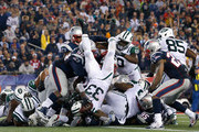 Chris Ivory #33 of the New York Jets scores a touchdown during the third quarter against the New England Patriots at Gillette Stadium on October 16, 2014 in Foxboro, Massachusetts.