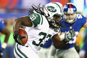 Chris Ivory #33 of the New York Jets runs with the ball against the New York Giants during their pre season game at MetLife Stadium on August 24, 2013 in East Rutherford, New Jersey.