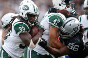 Chris Ivory #33 of the New York Jets rushes against the Oakland Raiders during their NFL game at O.co Coliseum on November 1, 2015 in Oakland, California.