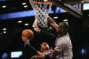 Carmelo Anthony #7 of the New York Knicks heads for the net as Kevin Garnett #2 of the Brooklyn Nets blocks at the Barclays Center on February 6, 2015 in the Brooklyn borough of New York City. NOTE TO USER: User expressly acknowledges and agrees that, by downloading and/or using this photograph, user is consenting to the terms and conditions of the Getty Images License Agreement.