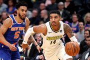 Gary Harris #14 of the Denver Nuggets drives past Courtney Lee #5 of the New York Knicks at the Pepsi Center on January 25, 2018 in Denver, Colorado. NOTE TO USER: User expressly acknowledges and agrees that, by downloading and or using this photograph, User is consenting to the terms and conditions of the Getty Images License Agreement.