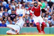 Jay Bruce #19 of the New York Mets slides safe into home plate past Christian Vazquez #7 of the Boston Red Sox in the seventh inning of a game at Fenway Park on September 16, 2018 in Boston, Massachusetts.