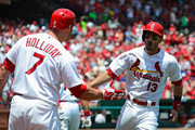 Matt Carpenter #13 of the St. Louis Cardinals celebrates with Matt Holliday #7 after hitting a solo home run during the first inning at Busch Stadium on June 18, 2014 in St. Louis, Missouri.