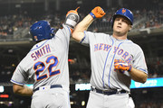 Jay Bruce #19 of the New York Mets celebrates a solo home run with Dominic Smith #22 in the third inning pitches during a baseball game against the Washington Nationals at Nationals Park on September 20, 2018 in Washington, DC.
